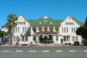 Railway station in Windhoek. The plinthed locomotive is a Zwillinge, number 154A